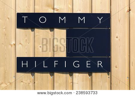 Villefranche, France - June 11, 2017: Tommy Hilfiger Logo On A Wall. Tommy Hilfiger Is An American M