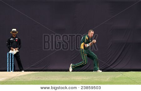 PUCHONG, MALAYSIA - SEPT 24: Guernsey's fielder Jeremy Frith makes a catch in this Pepsi ICC WCL Div 6 finals against Malaysia at the Kinrara Oval on September 24, 2011 in Puchong, Malaysia.