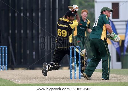 PUCHONG, MALAYSIA - SEPT 24: Malaysia's Hammad Ullah Khan (69) eyes a boundary hit in this Pepsi ICC World Cricket League Div 6 finals at the Kinrara Oval on September 24, 2011 in Puchong, Malaysia.