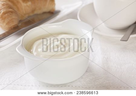 Yoghurt  Breakfast - Bowl Of Yoghurt For Breakfast With Coffee And Croissant.