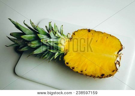 Pineapple. Fruits On The Table. Rich Yellow Color