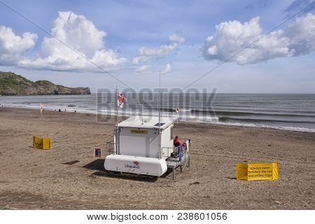 20 May 2017: Whitby North Yorkshire Uk - Lifeguard On Duty At Sandsend Beach, North Of Whitby On The