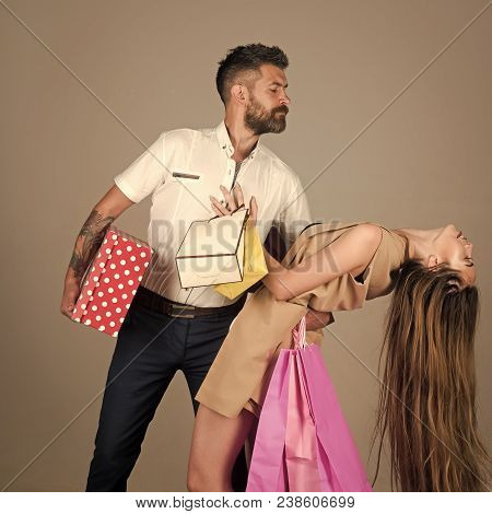 Fashion Shopaholic Couple. Black Friday, Happy Holiday, Relations. Girl And Bearded Man Hold Present