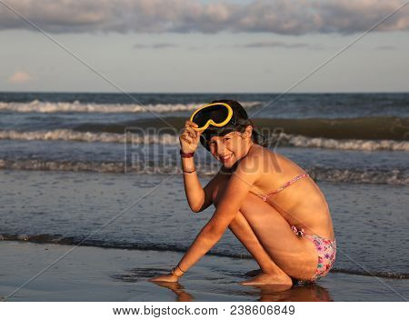 Little Girl Raises Her Diving Mask By The Sea After Diving And Smiling