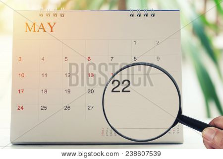 Magnifying Glass In Hand On Calendar You Can Look Twenty-two Day Of Month,focus Number Twenty-two In