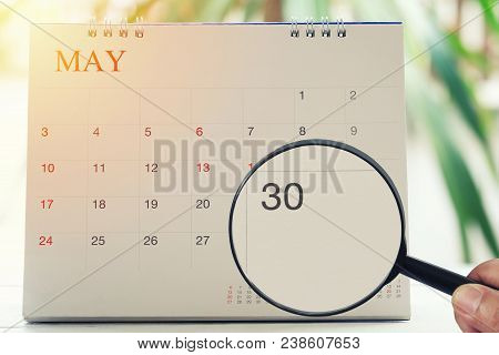 Magnifying Glass In Hand On Calendar You Can Look Thirty Day Of Month,focus Number Thirty In May,con