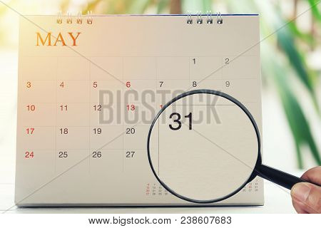 Magnifying Glass In Hand On Calendar You Can Look Thirty One Day Of Month,focus Number Thirty In May