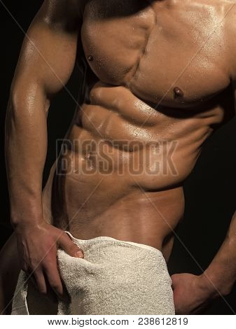 Sport And Workout. Man With Muscular Wet Body And Torso In Bath Towel. Athletic Bodybuilder Man On B