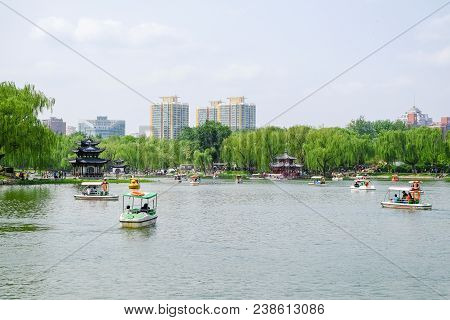 People In A Park. Taoranting Park Is A Major City Park Located In Beijing, China.