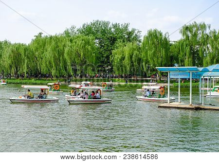 Beijing, China - April 30, 2018: People Are Taking A Recreational Boat Ride In A Park. Taoranting Pa