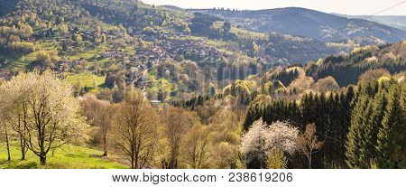 French Landscape - Vosges. Panoramic View Of A Small Village In The Vosges With Mountains In The Bac