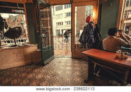 Antwerp, Belgium - Mar 30: Bar With Men Drinking Beer In Vintage Interior And Streetlife Outdoor On