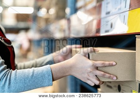 Asian Woman's Hand Shopping In Self Picking Box,package And Collect Product From Shelf,rack In Wareh