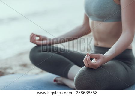 Young Woman Is Engaged In Yoga At Seaside. Transcendental Meditation.