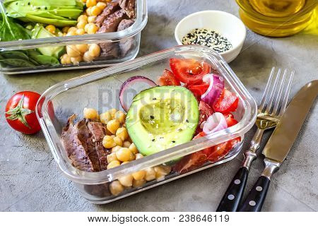 Healthy Meal Prep Containers With Chickpeas, Goose Meat , Tomatoes, Avocado, Lemon And Spinach. Top