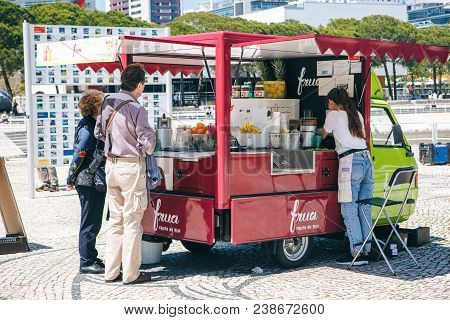 Portugal, Lisbon 29 April 2018: People Buy Drinks Or Ice Cream In Van Or Station Wagon