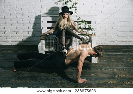 Retro Woman Put Legs On Back Of Muscular Man. Muscular Man Training Sport At Pretty Young Girl. Coup