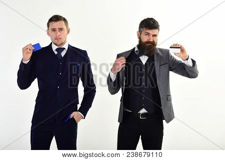 Businessmen, business partners in suits holding plastic credit cards, isolated on white. Creditors offering to create banking account, get money for business. Credit and banking account concept. poster