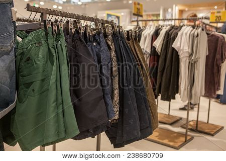 Shorts On The Store Shelf. Fashionable Clothes On The Shelves In The Store. Shorts Hanging On The Ve