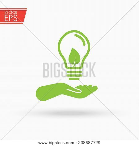 Green Ecology Bulb On Hand. Light Bulb In Hand. Ecology Bulp Lamp With Leaf Logo. Energy Saving Lamp
