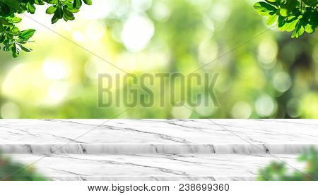 Empty White Marble Table Top With Blur Tree In Park With Bokeh Light At Background,mock Up Template