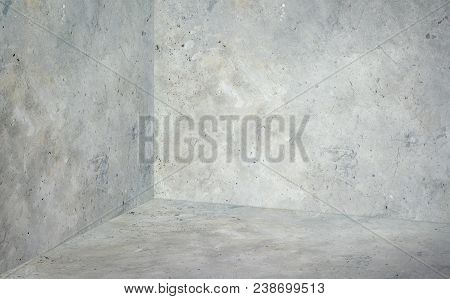 Empty Corner Room With Grey Concrete Wall And Floor Background,mock Up Studio Room For Display Or Mo