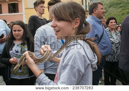 Cocullo, Italy - May 1, 2018: Portrait Of Pretty Child With Snake At The Feast Of Saint Dominic In T