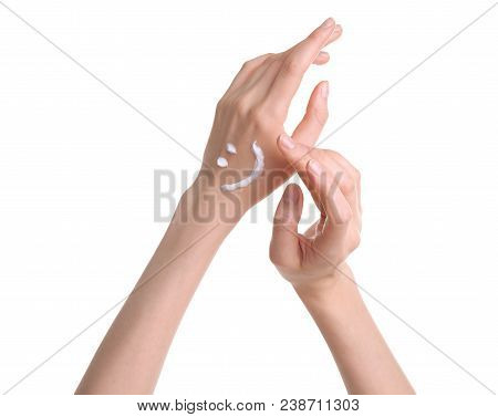 Young Woman Applying Hand Cream Against White Background