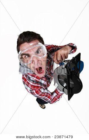 An impatient man using a circular saw