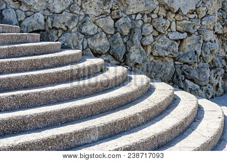 Background Texture, Old Stone Wall And Concrete Semicircular Stairs.