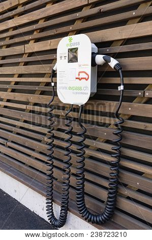 Schwyz, Switzerland - April 20, 2018. Electric Car Charging Station. Power Supply For Electric Car C
