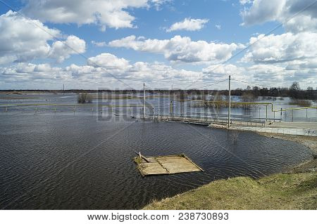 Spring Flood In Rural Terrain On Background Blue Sky