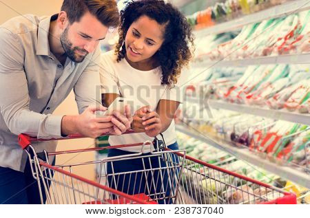 Couple shopping together at a supermarket