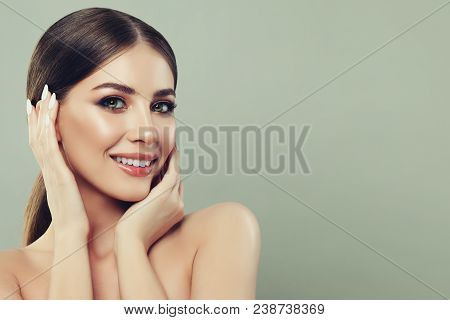 Spa Woman Smiling And Touching Her Hand Her Face On Banner Background With Copy Space For Text. Spa