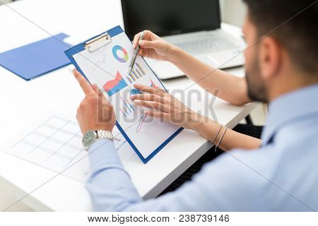 Business people working on a business document