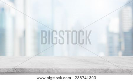 Empty White Marble Stone Table Top And Blur Glass Window Wall Building With City View Background - C