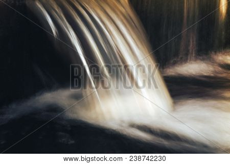 Cold Waterfall Long Exposure. Closeup View Of Little Waterfall On The River Current In The Moonlight