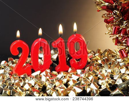 New Years Eve 2019 Background For New Years Eve, With Lit Red Candles Showing The Number 2019.