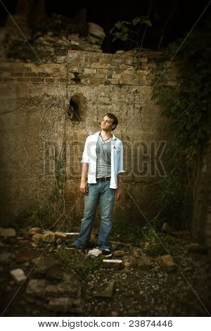 Man Standing By An Old Wall