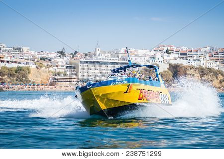 Benagil, Portugal - September 11, 2016: Speed Boat Or Jet Boat Ride And Dolphin Watching Experience