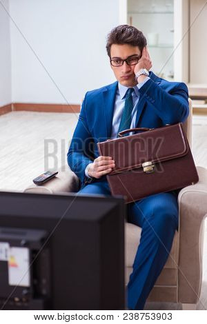 Businesman watching tv in office