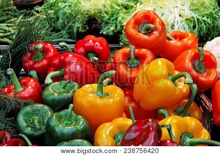 Fresh Green, Red And Yellow Bell Peppers Paprika On A Market.