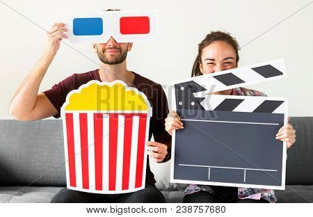 Couple watching movie at home together
