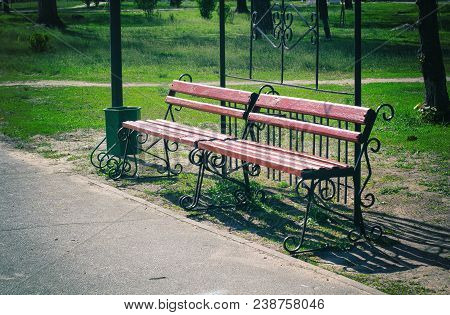 Beautiful Bench In The Park. Spring Sunny Day. Old Photo Bench Benches In The Park