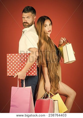 Black Friday, Happy Holiday, Relations. Girl And Bearded Man Hold Present Pack, Cyber Monday. Fashio
