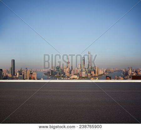 Empty Road Floor Surface With City Landmark Buildings At Shanghai Skyline