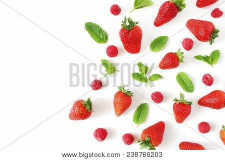 Styled Stock Photo. Summer Healthy Fruit Composition With Red Strawberries, Raspberries, Fresh Green
