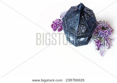 Ornamental Dark Moroccan, Arab Lantern With Lilac Flowers On The White Table. Greeting Card For Musl