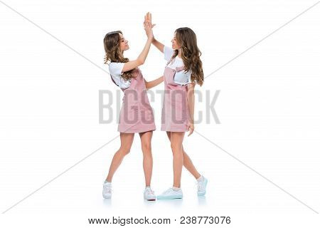 Beautiful Young Twins Giving High Five Isolated On White