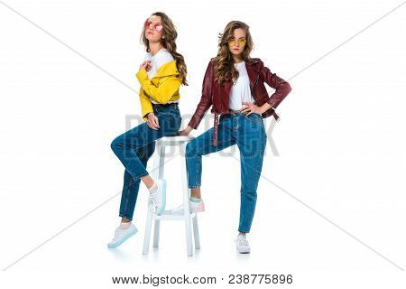 Attractive Stylish Twins In Leather Jackets And Sunglasses With Wooden Chair Isolated On White